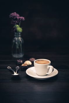 Espresso with chocolate candies on a wooden background by Christian Fischer on 500px