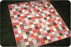 Coral and brown baby quilt made for an adorable little girl (in five days!). Tie quilting.