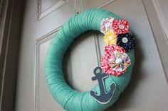 Nautical Yarn Wreath - Aqua/Green With Flowers and Anchor. $25.99, via Etsy.
