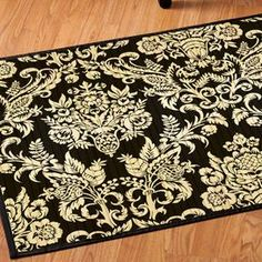 Bamboo rug with a damask motif.  Product: RugConstruction Material: BambooColor: Brown and creamDimensions: 3' x 5'Note: Please be aware that actual colors may vary from those shown on your screen. Accent rugs may also not show the entire pattern that the corresponding area rugs have.