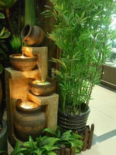 This Indoor / Outdoor 4-Tier Pots Water Fountain with LED Lights ...