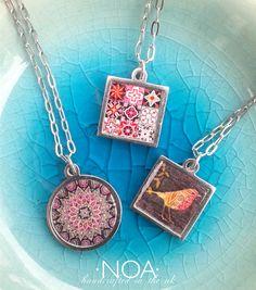 NOA Jewellery stainless steel & decorated walnut pendants. www.noajewellery.com
