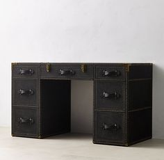 RH TEEN's Eldon Steamer Trunk Storage Desk:Inspired by classic steamer trunks, our collection's sturdy canvas-covered frame features hand-hammered nailheads, burnished-leather handles and decorative locks – authentic details with vintage appeal.