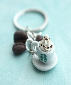 Starbucks Coffee Keychain starbucks coffee keychain<br> This key chain features a miniature cup of Starbucks coffee along with some handmade espresso bean charms sculpted from polymer clay. The entire key chain length is 3 inches. Coffee Latte, Starbucks Coffee, My Coffee, Coffee Drinks, Coffee Mugs, Starbucks Logo, Coffee Girl, Coffee Scrub, Coffee Coffee