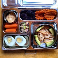 Kid's Lunch - Carrots & hummus, blackberries, sweet potato fries, chicken & avocado, boiled egg, and pistachios.