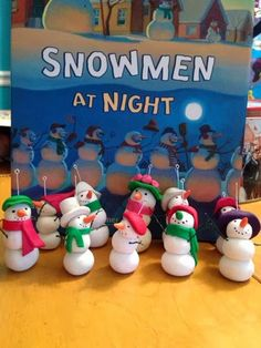 "polymer clay snowmen modeled after the snowmen in ""Snowmen at Night."""