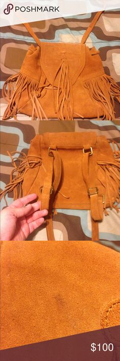 Ecote genuine suede leather backpack purse Beautiful bag.  Has a small dirty mark on the front but barely noticeable and can probably be cleaned.  Genuine suede leather and pretty fringe.  You can carry it over your shoulder, across you as a crossbody, or carry on your back as a backpack.  Drawstring and snap closure. Ecote Bags