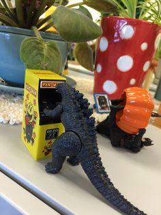 Godzilla likes playing Pac Man