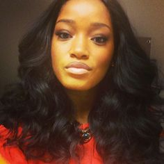 Keke Palmer.  Middle part, length is not too long - I really like this look.  Very natural.