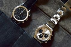 1963 Heuer Carrera 2447N vs 1970 Rolex Cosmograph Daytona 6262.  Both powered by (some variation of) the Valjoux 72 chronograph movement, both with pump pushers.