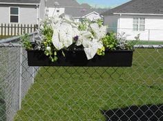 flowers hanging on chain link fence - Google Search