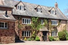 Dragon House is a pet friendly holiday home sleeping up to 22 guests in a quiet rural location on the West Somerset coast near Dunster and Exmoor. Dragon House, Pet Friendly Holidays, Somerset, Renting A House, United Kingdom, National Parks, England, Exterior, Cabin