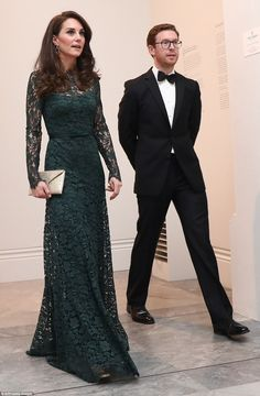 The Duchess of Cambridge walks with Nicholas Cullinan Director of the National Portrait Gallery, as she arrives to attend the 2017 Portrait Gala,
