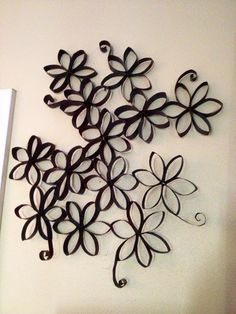 """Toilet paper rolls turned into awesome art.   Cut rolls into 1/2"""" rolls, glue together and spray paint....that easy!!"""