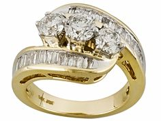 A beautiful past, present, and future diamond ring is the perfect gift for the love of your life. | 2.00ctw Round & Baguette Diamond 14k Yellow Gold Ring