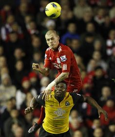 Liverpool's Martin Skrtel (top) challenges Blackburn Rovers' Yakubu during their English Premier League soccer match at Anfield in Liverpool, northern England. (Reuters)