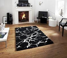 Elements Hand Tufted 100% Wool Rug Splash Effect Stylish Centre Piece 90cm x 150cm (Black) Think Rugs http://www.amazon.co.uk/dp/B00L948VMA/ref=cm_sw_r_pi_dp_Hylzvb0BFMEMC