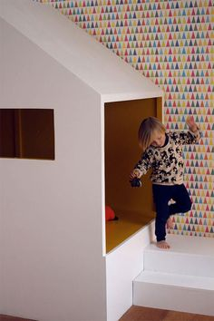 Handmade cabin bed in a kid's room in France - the wallpaper