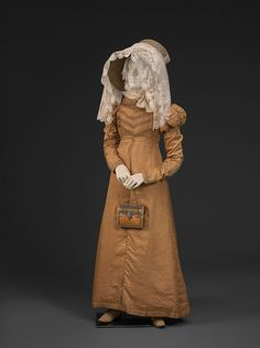"""Pelisse, Late 1810s  A wide-brimmed bonnet, gloves, a stylish purse, and practical leather """"half-boots"""" reaching to above the ankle"""