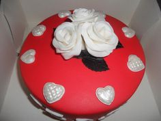 Red cake with white flowers