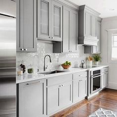 Gray Kitchen with White Honeycomb Tiles