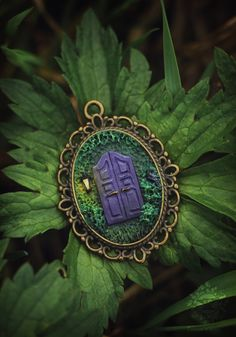 Polymer clay pendant with mystical violet door. There is piece of the ancient mystical forest where the lantern always lights up. The mysterious door is guarded by a wise raven. The size of raven is about 3 mm. Totally handmade. You can choose a chain or a waxed cord in addition to pendant.  ✨MATERIALS: Polymer clay, pastel, acrylic paints and varnish, metal frame in bronze color.  ✨COLORS: Green, violet, yellow, black, bronze. The real color may differ slightly from those that you see on…