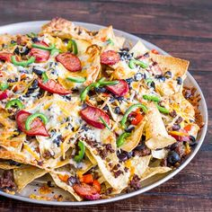 Spicy Beef and Cheese Nacho's - Best macho nachos recipe to keep you busy on game day
