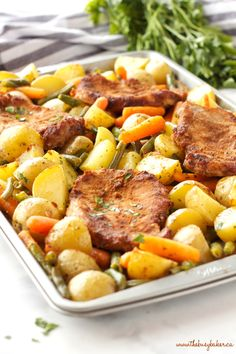 Easy Pork Chop Sheet Pan Dinner with potatoes, carrots and green beans