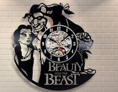 Beauty and the Beast vinyl wall clocked is crafted from an old vinyl record. Recycled!