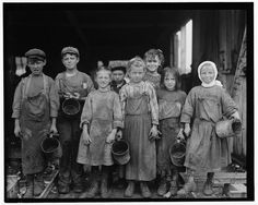 +~+~ Antique Photograph ~+~+  Children forced to grow up much too soon shucking Oysters. 1912.  Nine of them from 8 years old up go to school half a day, and shuck oysters for four hours before school and three hours after school on school days, and on Saturday from 4 A.M. to early afternoon. Photograph by Lewis Hine.