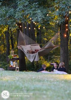 Love the white lights above the hammock.  And the drink  snack stand set up nearby.