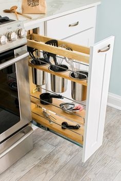 Get the most out of a narrow space with a pull-out cabinet, like this one from Home Depot.