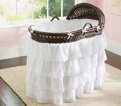 If I have another baby, I am absolutely making one of these skirts for my bassinet.......out of ruffled bedskirts from Target.......for a fraction of the cost..........:)