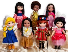In honor of the rides 50th anniversary in 2014, Disney will come out with this collection of It's A Small World Dolls.  And I think they sing!