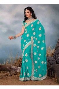 Enhance your style with this amazing designer saree. This saree in sea green color is crafted in 60 gram georgette material.
