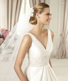 Pronovias Costura Collection Dallas dress. V-neck, wide floral beaded band at waist.