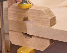 Clamp blocks force the boards to align perfectly to achieve a flat solid wood panel. I might have to try this.: