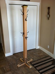 Coat tree. 1 4x4 post , 8 hooks , one fence topper. 4 shelve brackets, 1 2x4 24 inches. 2 2x4 10 inches
