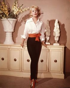 "((Sandra Dee, 1960's era)) A diferent shade of ""prim"". Miss Sandra Dee, what a great lady. This piece is very ""moderne"" and could jump right into 2014....the narrow trousers, the 3/4 sleeve blouse, the stylish hair. This to me, is an enduring ""prim"" in that it is not aggressively sexual but pretty and feminine , while holding its' own!"