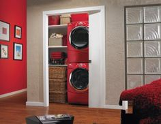 laundry room hidden in hall closet with red stackable washer and dryer. This Old House Hidden Laundry, Laundry Closet, Small Laundry Rooms, Laundry Room Organization, Laundry Room Design, Laundry Area, Organization Ideas, Compact Laundry, Laundry Doors