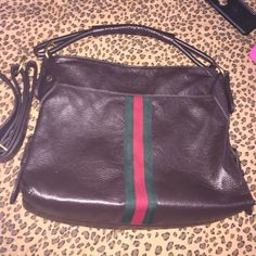 Gorgeous brown bag w/green and red stripe Making room for new items ‼️Really nice bag normal wear still has tons of life left! Has long strap and also can be worn as crossbody Great quality !!! Paid $200 Gucci Bags Shoulder Bags