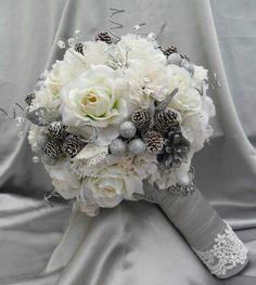 Winter wedding bouquet with miniature pine cones.