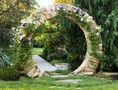 Round stone moongate at Garden Gate Landscaping - woooow