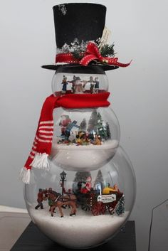 loving my latest Christmas craft. Glass Fishbowl snowman with frosty hat filled with lemax figurines Fish bowl glass tree snow