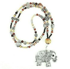 "Lucky Elephant Gemstone Charm Necklace Sweet silver tone bohemian elephant charm necklace. Created in my home-based workspace using semiprecious gemstones, ceramic, glass and silver beads,  approx 40"" long. Handmade with love.   ****CUSTOM ORDERS ARE WELCOMED *** CroweArt Jewelry Necklaces"