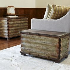 Features:  -Rustic wooden storage chest with feet and weathered and corrugated metal overlay.  -Tall and spacious and with black interior and lots of storage space.  -Hinged lid opens fully and stays