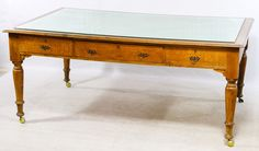 Lot 42: Oak Partner Desk; Having drawers on two sides, caster wheels and a glass top