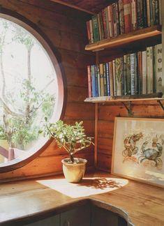 round window, kitchen nook with books? Very hobbity