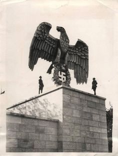 Huge German eagle, grasping a wreath with swastika as its center. The huge Third Reich eagle at the Luitpoldarena on the Nuremberg Reich Party grounds by sculptor Kurt Schmid-Ehmen.