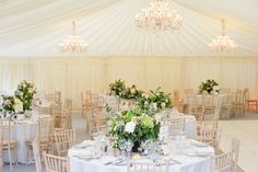 Classic Marquee Reception - Image by Source Images - Multicultural Hindu & English wedding with traditional sari dress for a classic orangery reception in the Cotswolds with a Black Cab Photo Booth.